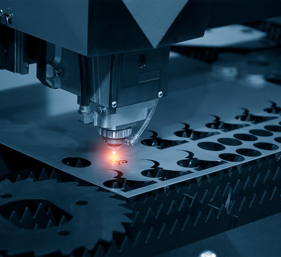 A factory machine performing laser cutting